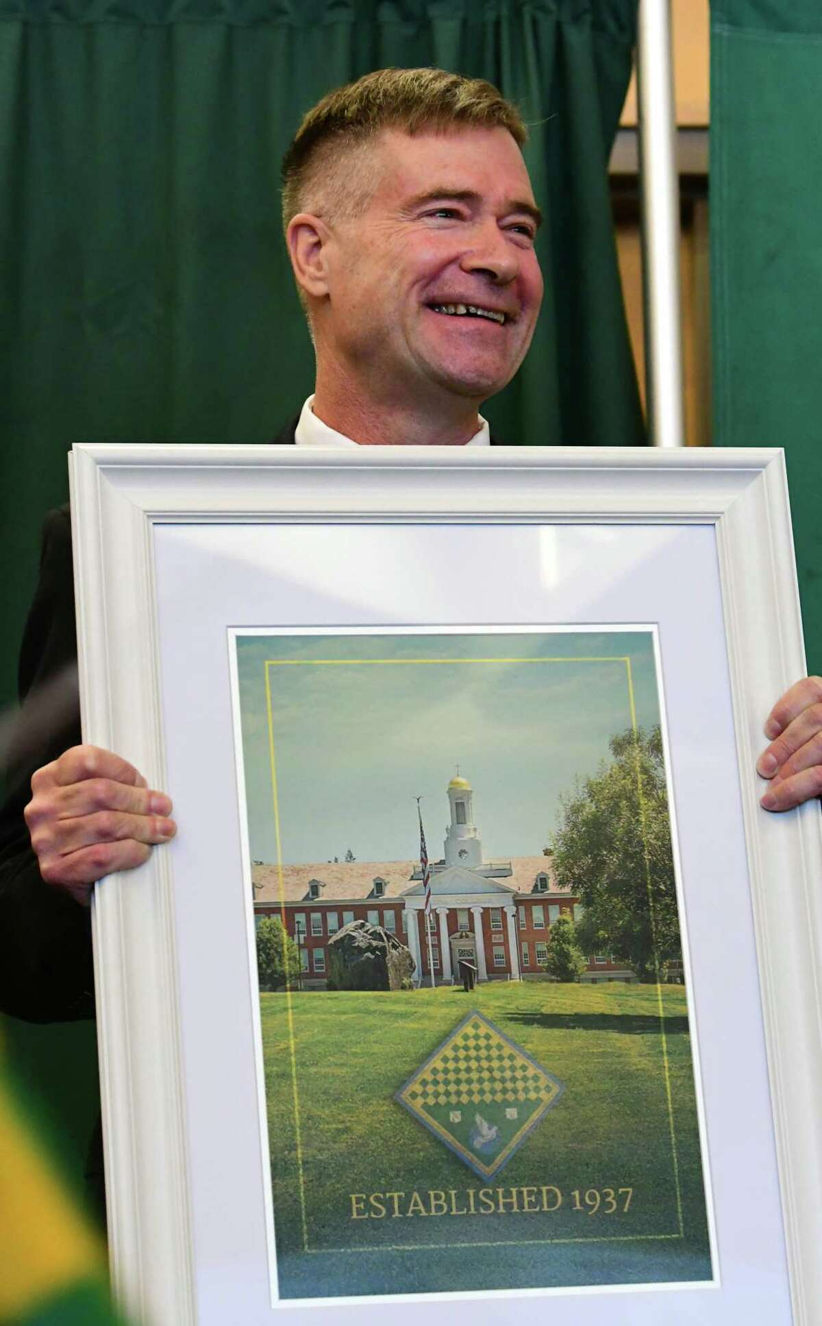 Former U.S. Rep. Chris Gibson receives a gift as Siena College announces him as its 12th president at Siena College on Friday, Feb. 14, 2020 in Loudonville, N.Y. Gibson, Ph.D, graduated from Siena in the class of '86. (Lori Van Buren/Times Union)