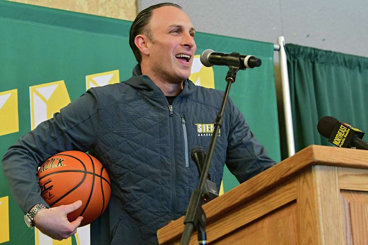 Carmen Maciariello, head coach men's basketball team, speaks before giving former U.S. Rep. Chris Gibson gifts as Siena College announces him as its 12th president at Siena College on Friday, Feb. 14, 2020 in Loudonville, N.Y. Gibson, Ph.D, graduated from Siena in the class of '86. (Lori Van Buren/Times Union)