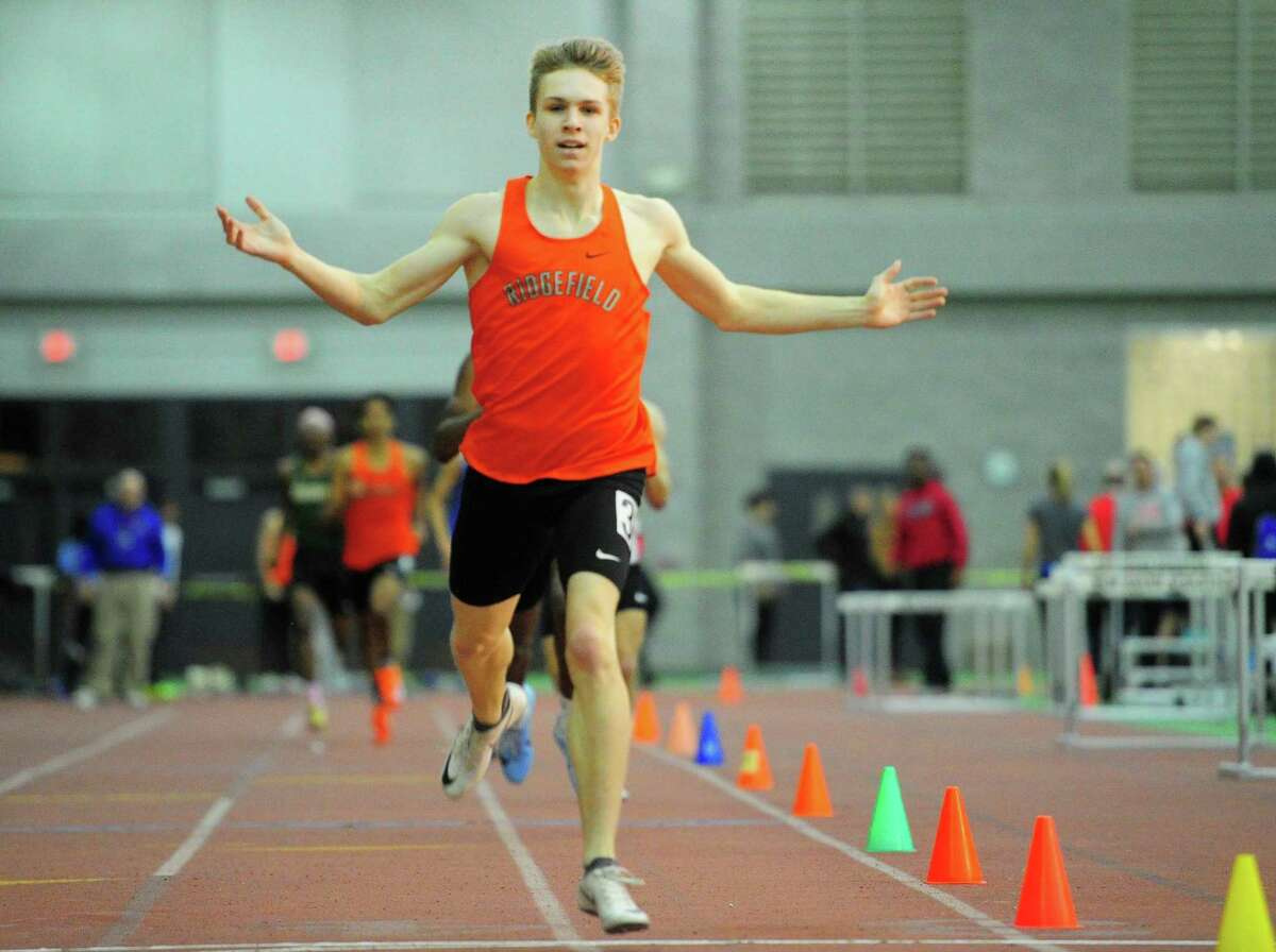 Ridgefield's Simon Jupp crosses the finish in the 600 meter race during CIAC Class LL Track Championship action in New Haven, Conn., on Thursday Feb. 13, 2020.