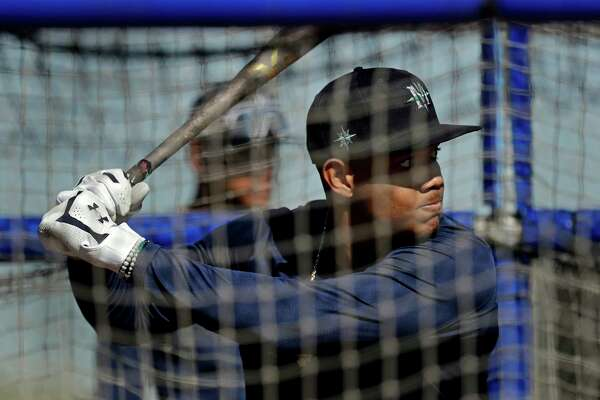 Seattle Mariners' Julio Rodriguez bats during spring training baseball practice Thursday, Feb. 13, 2020, in Peoria, Ariz.