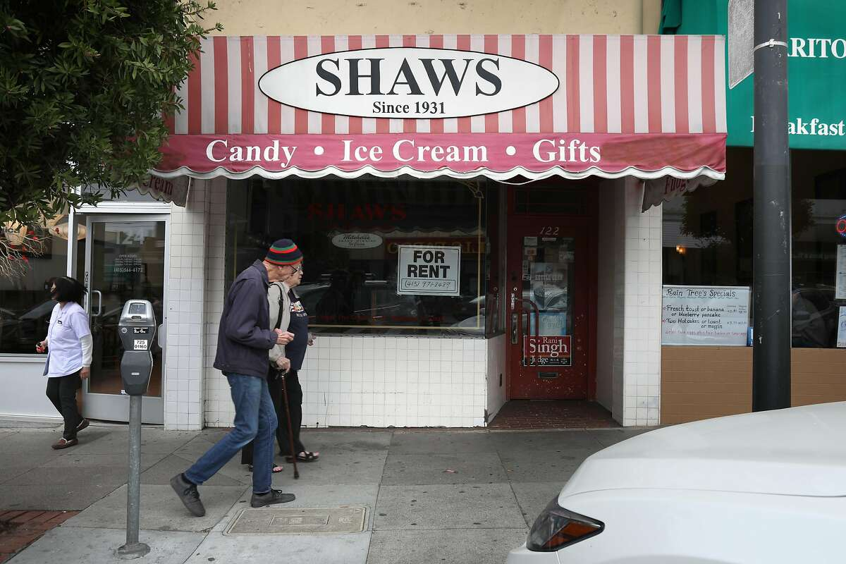 West Portal candy shop Shaws closes after 89 years in business as pedestrians are seen passing by on Friday, Feb. 14, 2020, in San Francisco, Calif.