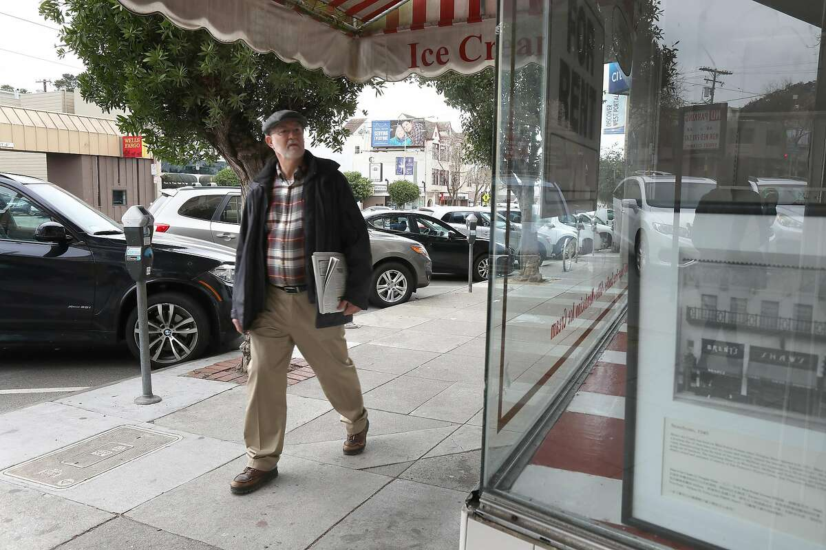 Mark Donnell passes by West Portal candy shop Shaws closes after 89 years in business seen on Friday, Feb. 14, 2020, in San Francisco, Calif. He�s been visiting the Shaws for the past 10 years.