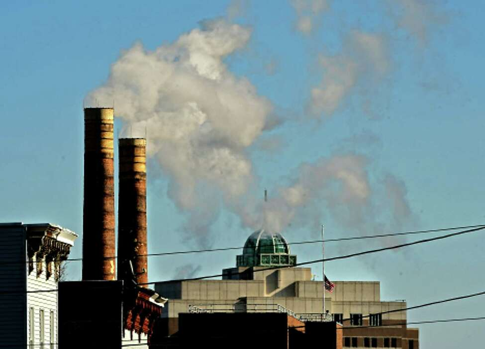 Smoke is seen coming out smoke stacks on Sheridan Ave. as the dome on the 677 building is partially covered on a frigid day on Friday, Feb. 14, 2020 in Albany, N.Y. (Lori Van Buren/Times Union)