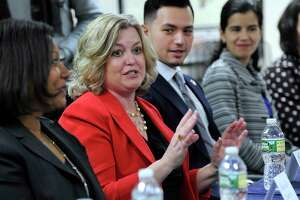 Kim Morgan, CEO of United Way of Western Connecticut, speaks Tuesday, Feb. 6, 2018, concerning a grant challenge that Danbury won to reduce poverty among immigrants and minorities. The Working Cities Challenge awarded Danbury and four other small cities in Connecticut $450,000.