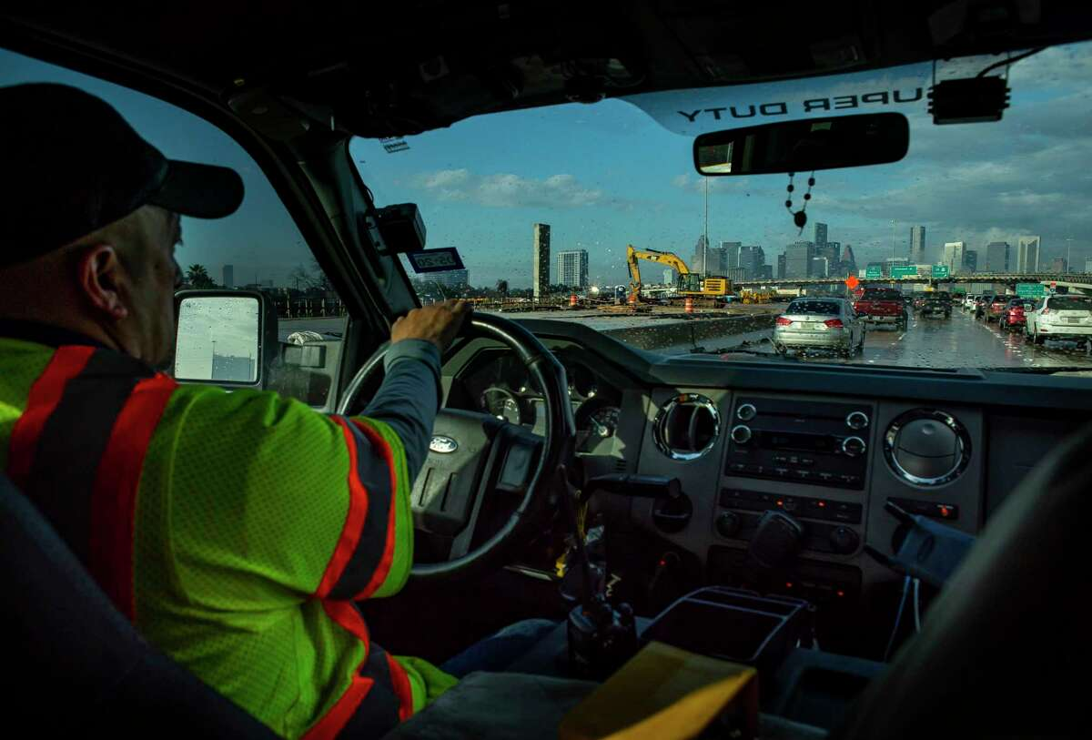Tow truck driver Rico Luna drives on Texas 288 toward downtown Houston while driving for the Tow & Go service on Jan. 28, 2020.