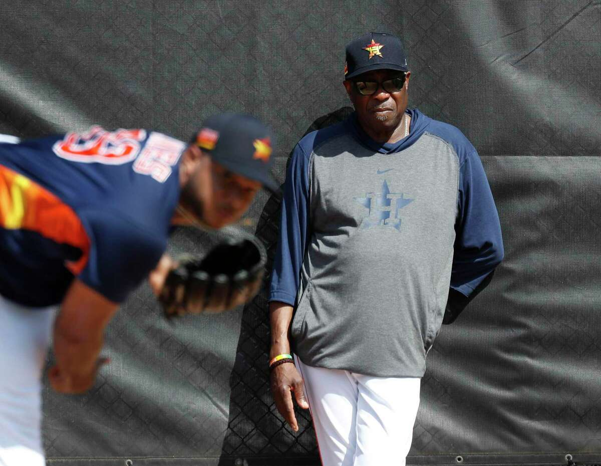 Houston Astros manager Dusty Baker Jr. watches pitcher Josh James (39) throw off the mound during the second day of the Houston Astros spring training workouts at the Fitteam Ballpark of The Palm Beaches, in West Palm Beach , Friday, Feb. 14, 2020.
