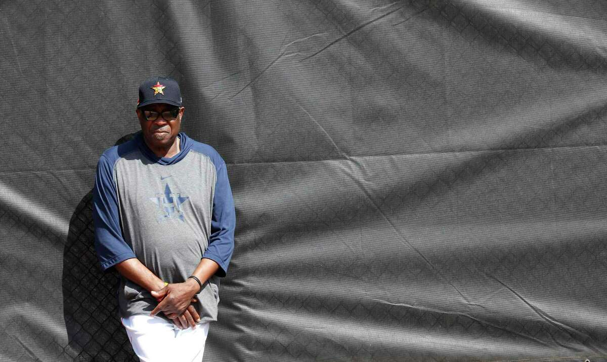 Houston Astros manager Dusty Baker Jr. watches pitchers throw off the mound during the second day of the Houston Astros spring training workouts at the Fitteam Ballpark of The Palm Beaches, in West Palm Beach , Friday, Feb. 14, 2020.