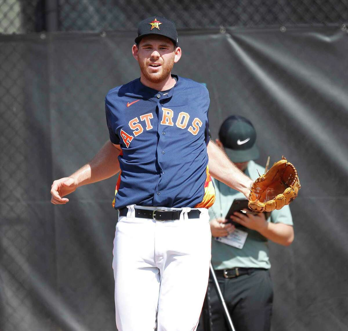 Houston Astros pitcher Joe Biagini (29) stretches his shoulders between pitches during the second day of the Houston Astros spring training workouts at the Fitteam Ballpark of The Palm Beaches, in West Palm Beach , Friday, Feb. 14, 2020.
