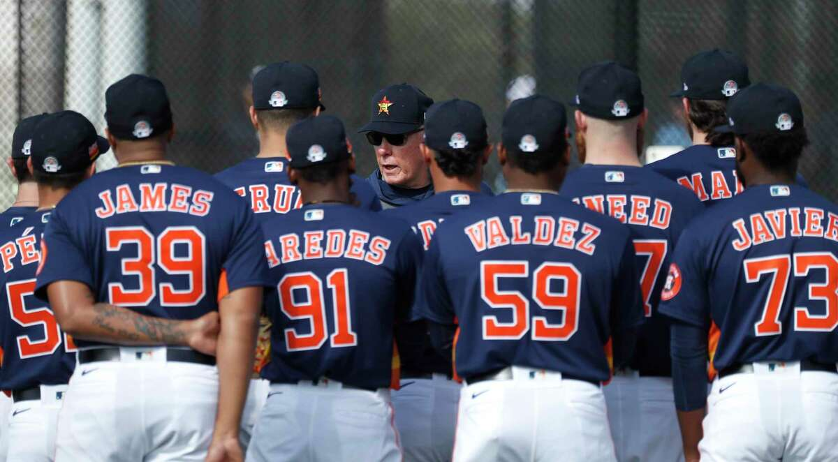 Houston Astros pitching coach Brent Strom (56) talks to his pitchers during the second day of the Houston Astros spring training workouts at the Fitteam Ballpark of The Palm Beaches, in West Palm Beach , Friday, Feb. 14, 2020.