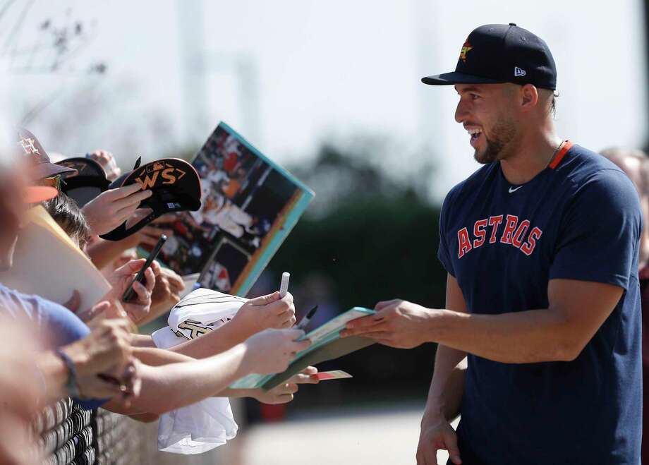 Houston Astros outfielder George Springer (4) signs autographs for fans during the second day of the Houston Astros spring training workouts at the Fitteam Ballpark of The Palm Beaches, in West Palm Beach , Friday, Feb. 14, 2020. Photo: Karen Warren, Houston Chronicle / Staff Photographer / © 2020 Houston Chronicle