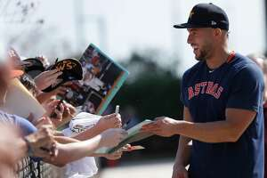 Houston Astros outfielder George Springer (4) signs autographs for fans during the second day of the Houston Astros spring training workouts at the Fitteam Ballpark of The Palm Beaches, in West Palm Beach , Friday, Feb. 14, 2020.