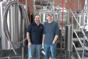Nils Johnson, left, and brewmaster Nate Day, co-founded and own Little Red Barn Brewers, along with Day's brother Matt.