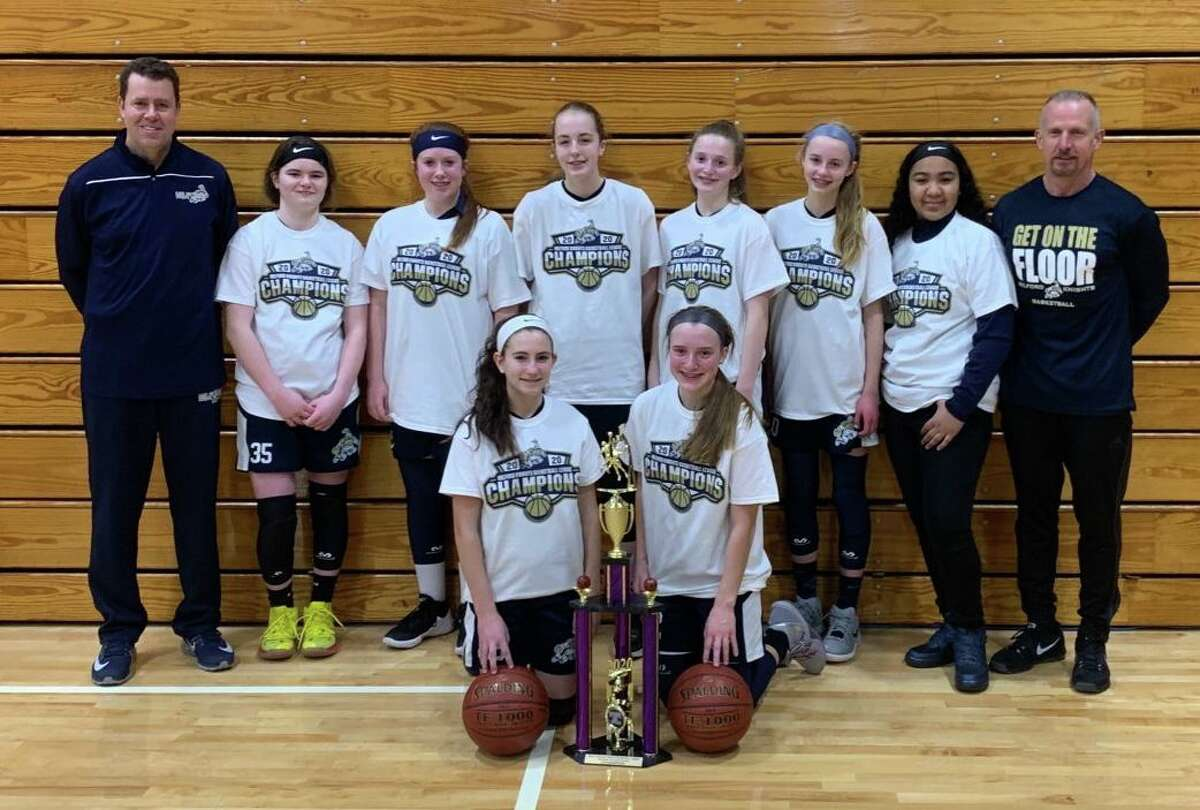 The Milford Knights 8th grade girls travel basketball team won its regular season and tournament title. Team members (front row) Maya Pinto and Abby Savoie; (second row) coach Trevor Doyle, Zoe Johnson, Erin Donegan, Chloe Haasch, Maggie Wetmore, Faith Doyle, Tiffany Rosado and coach Mike Donegan.