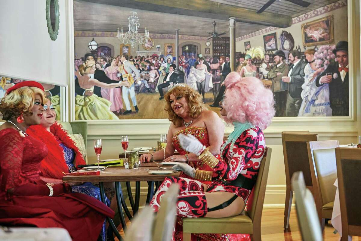 Some of New Orleans' best known drag queens pose in the dining room of Ralph's on the Park in New Orleans. The image is from