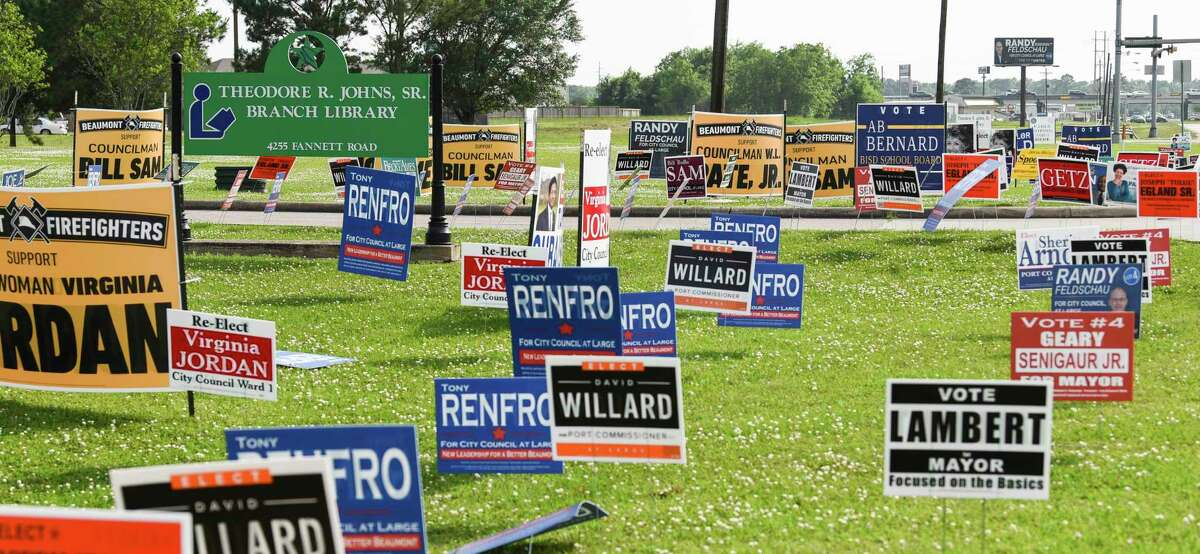 Signs line the road outside of Theodore R. Johns, Sr. Branch Library Tuesday as people vote early in the area's elections. Photo taken on Tuesday, 04/3019. Ryan Welch/The Enterprise