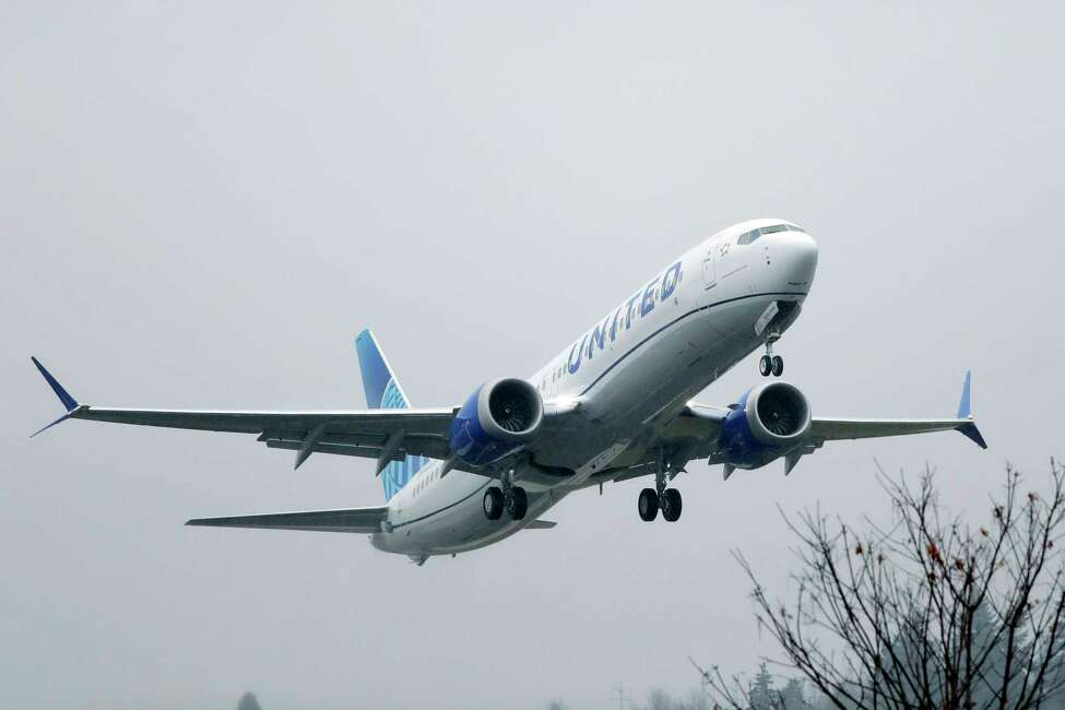 FILE - In this Dec. 11, 2019, file photo, an United Airlines Boeing 737 Max airplane takes off in the rain at Renton Municipal Airport in Renton, Wash. United Airlines said Friday, Feb. 14, 2020, that it is removing the grounded Boeing 737 Max from its schedule until early September, forcing it to cancel thousands more flights. (AP Photo/Ted S. Warren, File)
