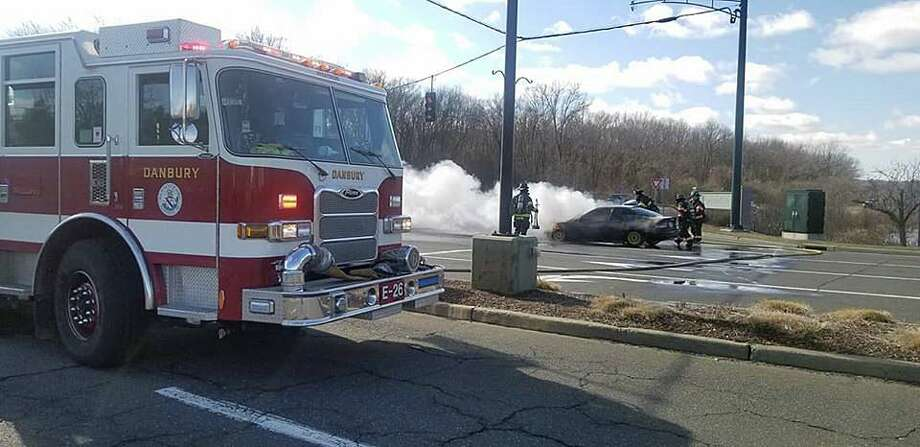 Firefighters quickly extinguished a car fire near the mall in Danbury, Conn., on Friday, Feb. 14, 2020. Photo: Contributed Photo / Danbury Fire Department