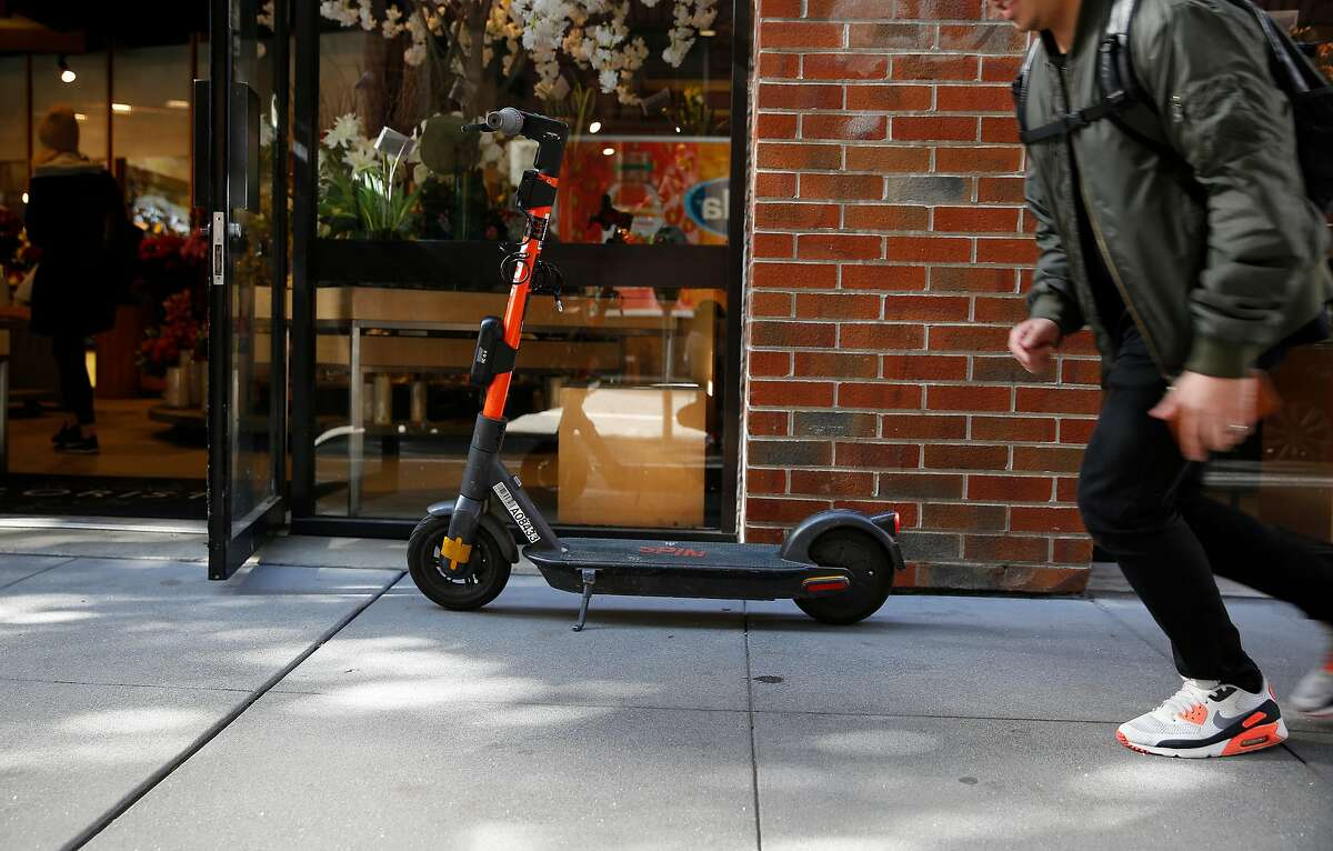 A scooter is seen parked along Howard Street near the entrance to a store on Friday, February 14, 2020 in San Francisco, Calif.