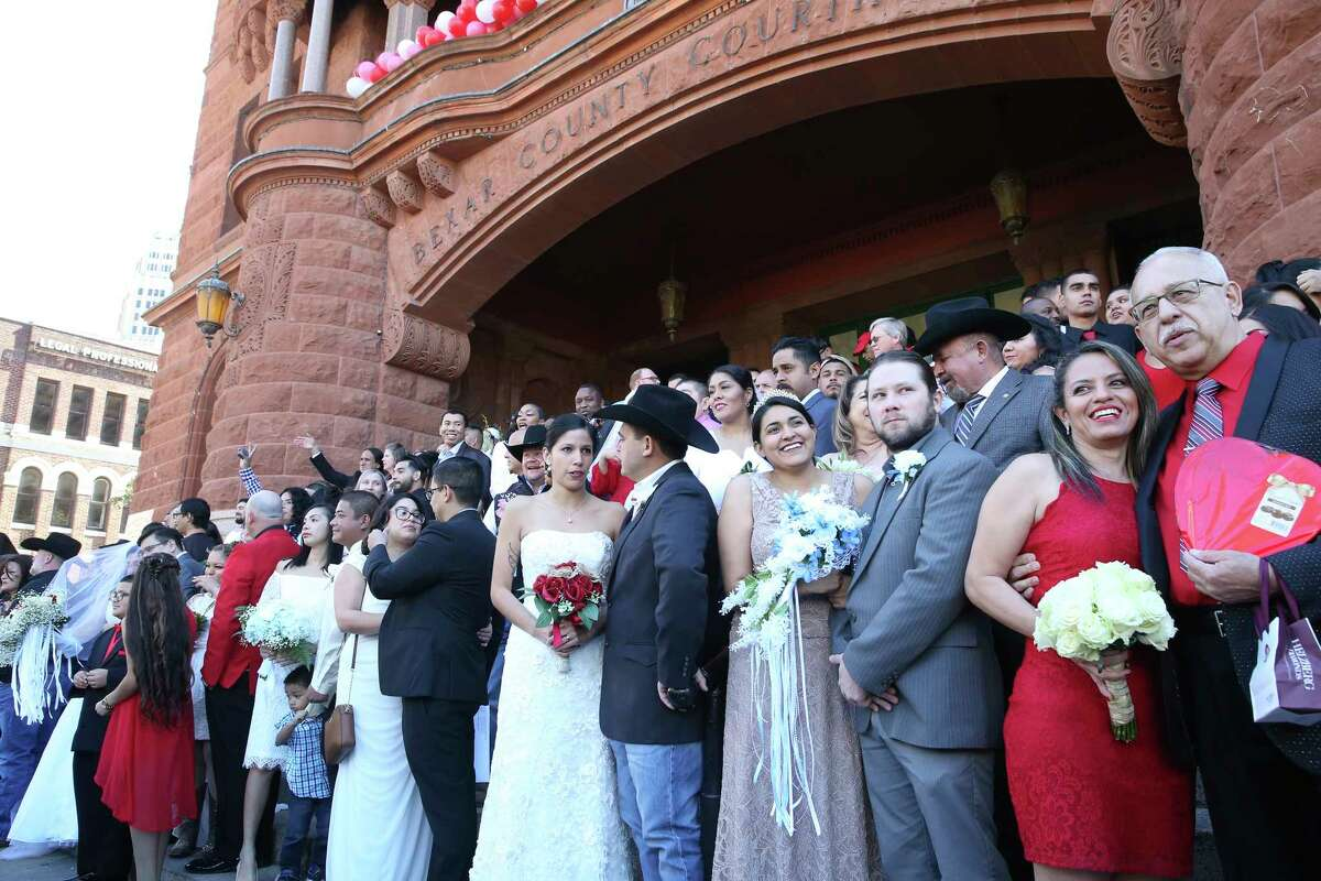 The group fills up available space before couples exchange vows on the steps of the Bexar County Courthouse in a Valemntine's Day ceremony on Feb. 14, 2020.