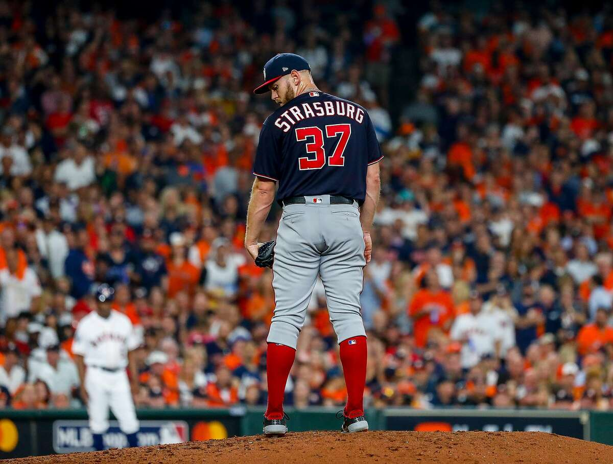 Washington Nationals starting pitcher Stephen Strasburg (37) checks the runner at first during the third inning of Game 2 of the World Series at Minute Maid Park in Houston on Wednesday, Oct. 23, 2019.