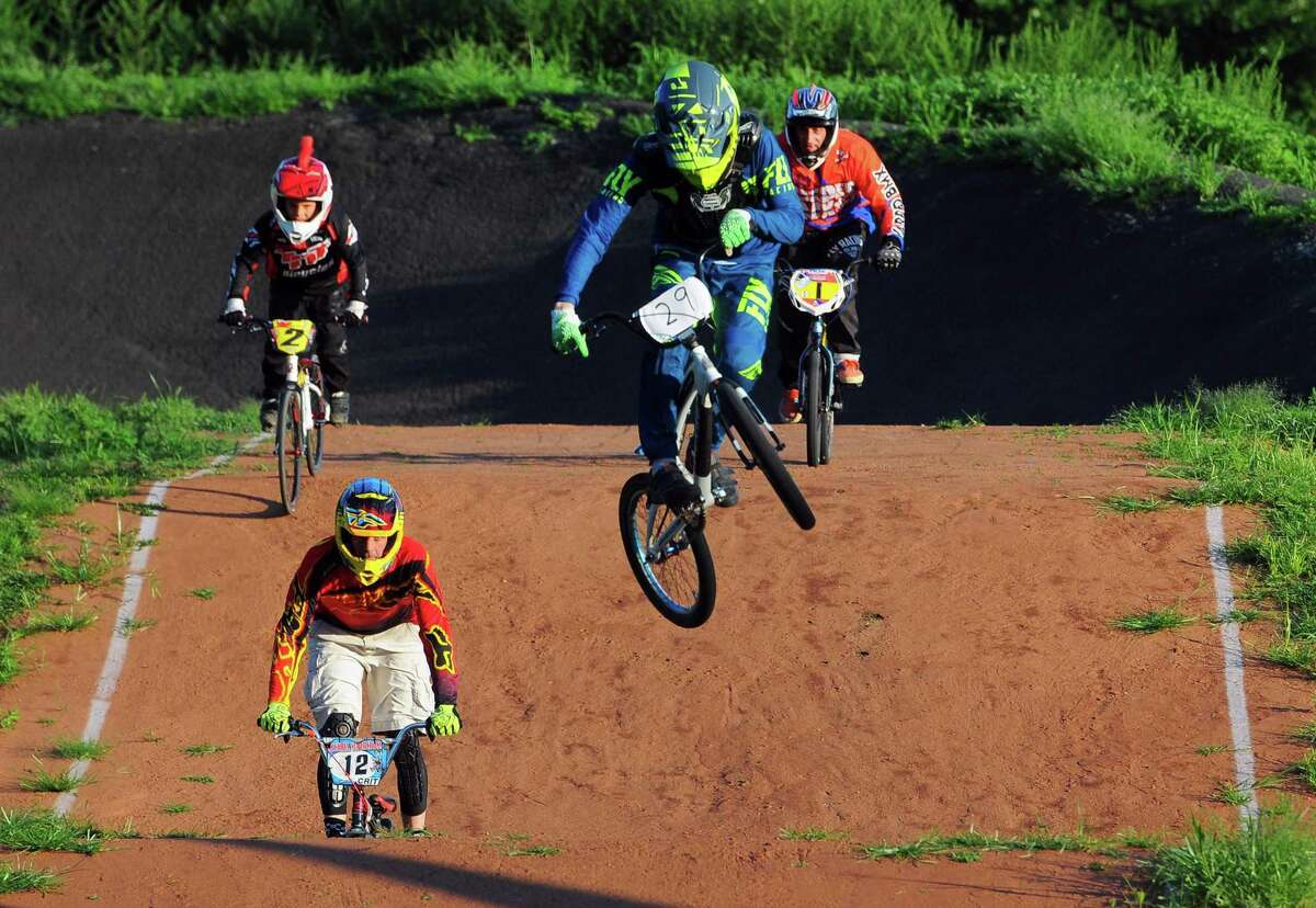 Henry Hatt, 15, of East Lyme, gets airborne as he takes a practice lap during BMX race night at the Trumbull BMX track at Indian Ledge Park in Trumbull, Conn., on Tuesday August 20, 2019. The Tuesday Summer Race Series runs: (6/18 through 9/3), Race Starts: 7:00 pm, practice/race registration: 5:00 pm - 6:30 pm.