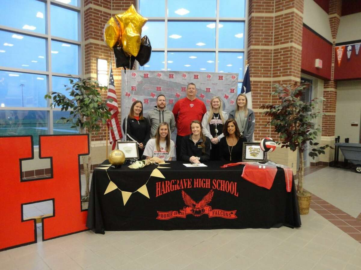 Surrounded by her coaches, Hargrave's Kylie Willis celebrates signing her letter of intent to play volleyball at Tyler Junior College at a ceremony at the school on the morning of Feb. 12