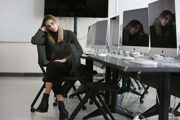 Olivia Wynkoop, San Francisco State student sits for a portrait in a journalism computer lab on Thursday, February 13, 2020 in San Francisco, Calif.