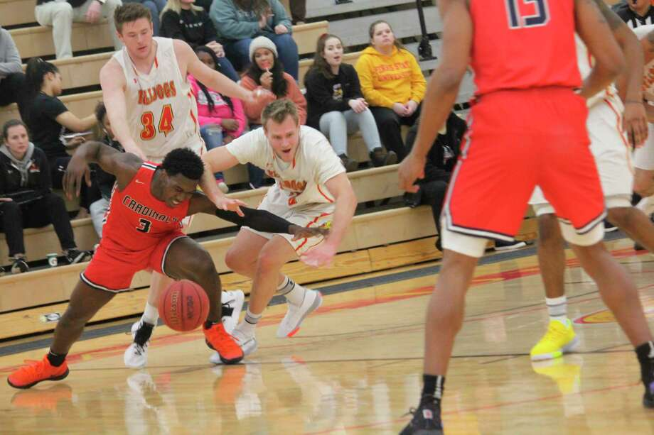 Greg WIlliams (15) and senior teammate Cole Walker (34) focus on defense in Ferris men's basketball action this season. (Pioneer file photo)
