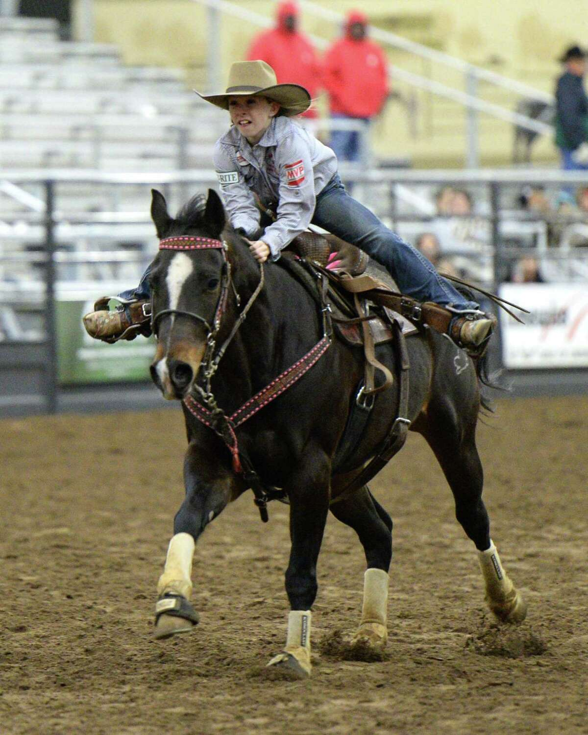 A rider participates in the barrel racing competition during the 77th Annual Katy ISD FFA Livestock Show and Katy Rodeo at the Gerald D. Young Agricultural Sciences Center in Katy, TX on Thursday, February 13, 2020.