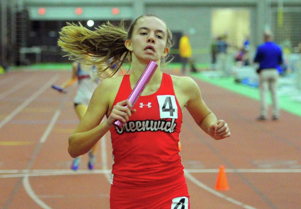 Greenwich's Grace Collier crosses the finish in a heat of the 4x800-meter relay during the CIAC Class LL Track Championships in New Haven, Conn., on Thursday Feb. 13, 2020.