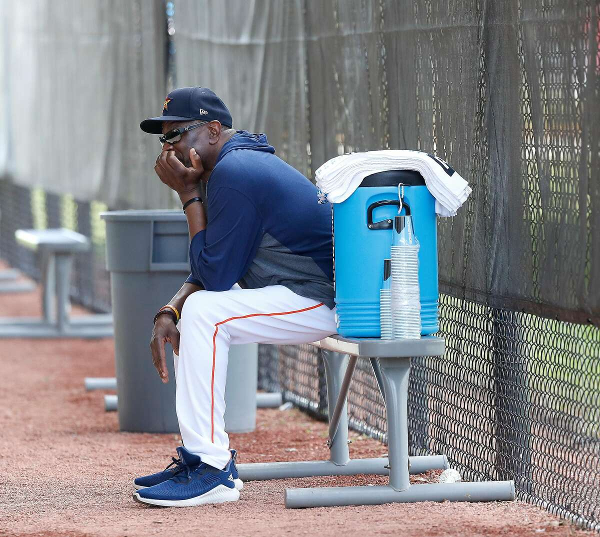 Houston Astros manager Dusty Baker Jr. sits quietly watching batting practice at the end of the second day of the Houston Astros spring training workouts at the Fitteam Ballpark of The Palm Beaches, in West Palm Beach , Friday, Feb. 14, 2020.