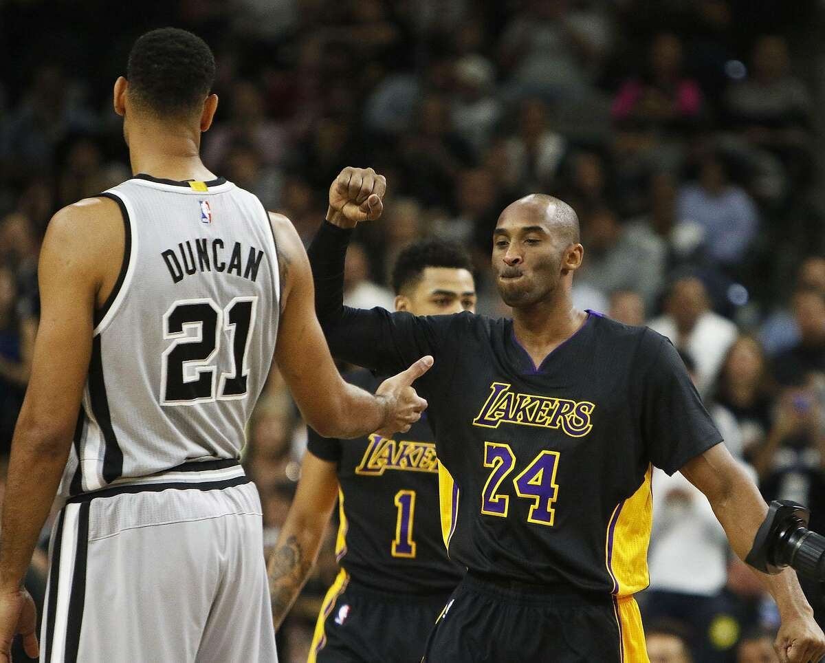 The Los Angeles Lakers' Kobe Bryant (24) greets the San Antonio Spurs' Tim Duncan before a game in San Antonio on Dec. 11, 2015.