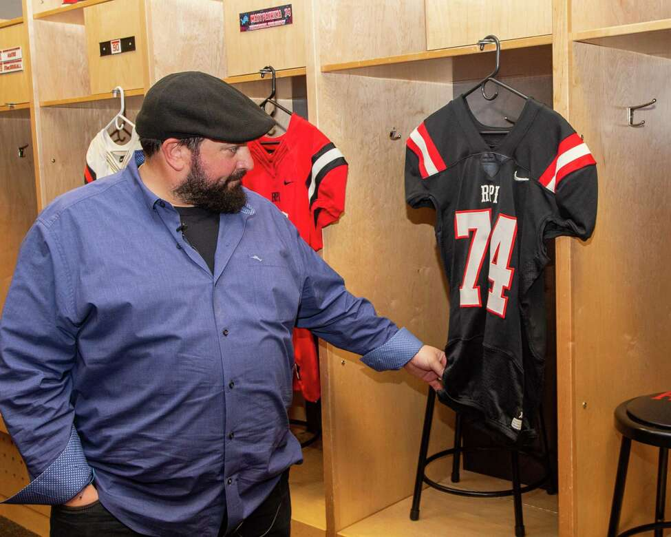 Detroit Lions Head Coach Matt Patricia, a former player and assistant coach at Rensselaer Polytechnic Institute, checks out a jersey with his old number on it during a tour of the college on Friday, Feb. 14, 2019 (Jim Franco/Special to the Times Union.)