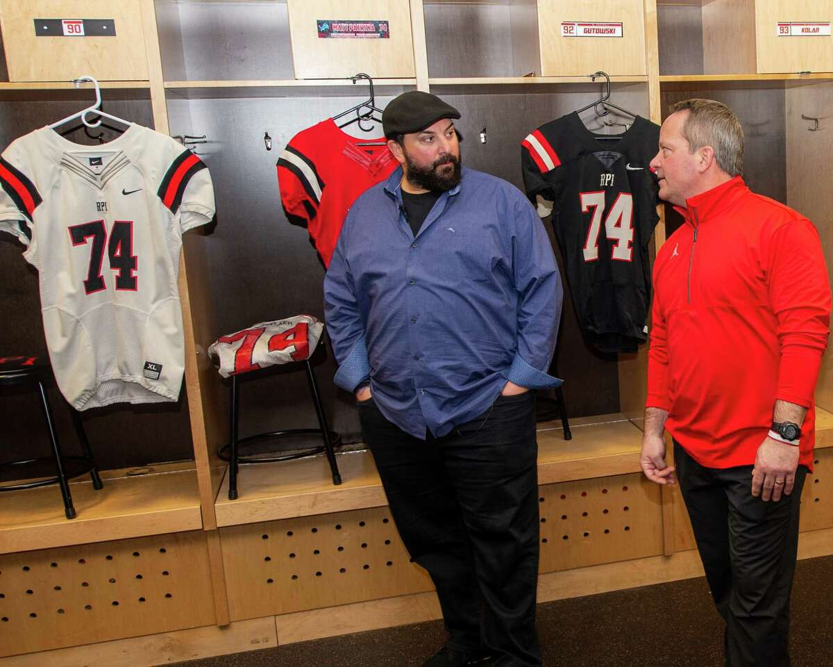 Detroit Lions Head Coach Matt Patricia, a former player and assistant coach at Rensselaer Polytechnic Institute, and RPI head football Coach Ralph Isernia chat in the locker room on Friday, Feb. 14, 2019 where jerseys with the number Patricia used to wear hang on the lockers (Jim Franco/Special to the Times Union.)