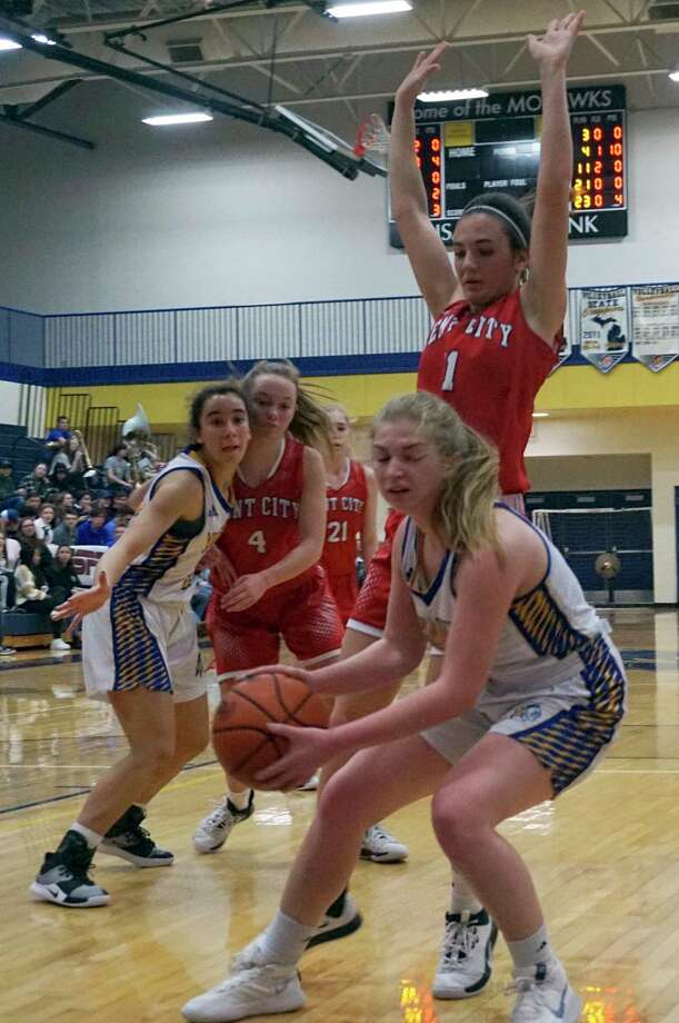 Morley Stanwood senior Emma Doyle corrals the ball while under heavy pressure during the Mohawk ladies' 42-30 defeat against Kent City on Friday night at Morley Stanwood High School. (Pioneer photo/Joe Judd)
