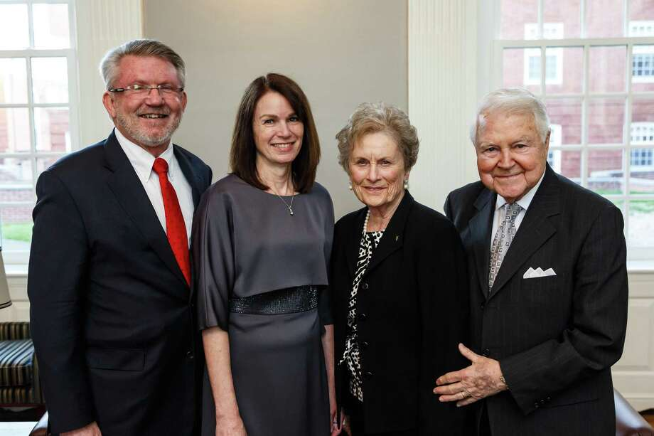 Carol and George Bauer of New Canaan, right, have given Yale Divinity School its largest gift ever, $15 million, to support the seminary's Living Village project. At left are Divinity School Dean Greg Sterling and his wife, Adrian Sterling. Photo: Yale Divinity School / Contributed Photo / Tony Fiorini / Tony Fiorini