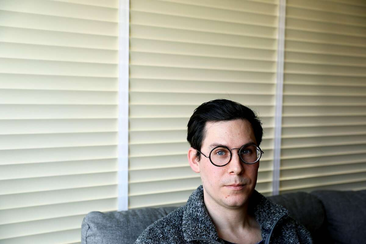 """Shaun Dunn, 38, poses for a portrait in his home in San Francisco, Calif., on Wednesday, January 1, 2019. Dunn, a 3D artist, is $400k in debt to the Academy of Art University, from which he holds an MFA and a BFA, and hopes to land a job in his design field. """"I think Walt Disney has been a big inspiration for me and his story just because, like I mentioned, he hit rock bottom and his main character was stolen, his employees were stolen from him and he didn't know how to protect himself when he was starting out. Later he created, he and his team created an amazing character - Mickey Mouse - and he ended up really changing the world with his company,"""" Dunn said. """"It just makes me feel inspired to keep going no matter where I am and how hard I hit bottom, I know that, you know, what goes up must go down and vice versa. Everything is just fluctuates and I believe that I will eventually go up."""""""