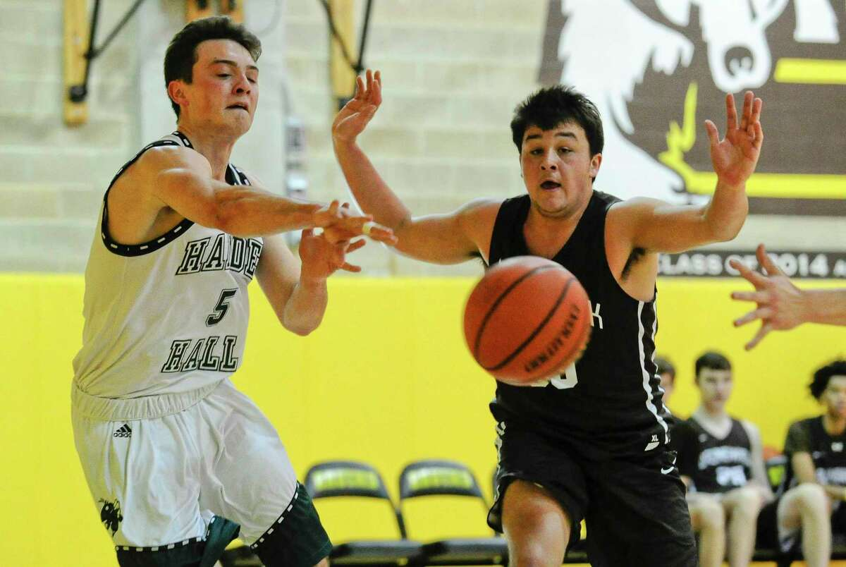 Hamden Hall's Jackson Bengni (5) passes off the ball under pressure from Brunswick's Henry Caponiti (35) in an FAA boys basketball game at Brunswick School on Friday in Greenwich. Hamden Hall defeated Brunswick 59-58.