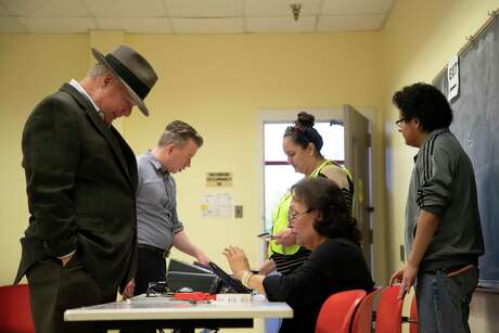 Voters wait to be assigned a polling booth at the MultiService Center on West Gray St. on Election Day on Tuesday, Nov. 5, 2019, in Houston.
