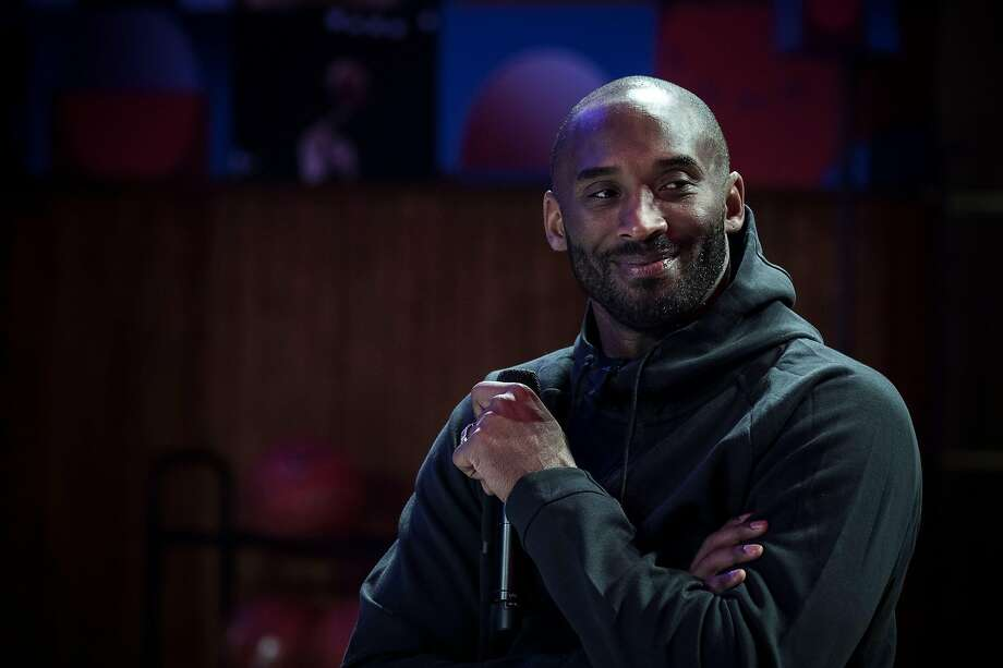 "(FILES) In this file photo taken on October 21, 2017 former NBA basketball player Kobe Bryant attends a promotional event organized by the sports brand Nike, for the inauguration of the infrastructure improvements of a local basketball playground at the Jean-Jaures sports hall ""Le Quartier"", in Paris. - Five-time NBA champion Kobe Bryant, the Los Angeles Lakers legend killed last month in a helicopter crash, was among eight finalists named February 14, for 2020 induction to the Basketball Hall of Fame. (Photo by PHILIPPE LOPEZ / AFP) (Photo by PHILIPPE LOPEZ/AFP via Getty Images) Photo: PHILIPPE LOPEZ / AFP Via Getty Images"