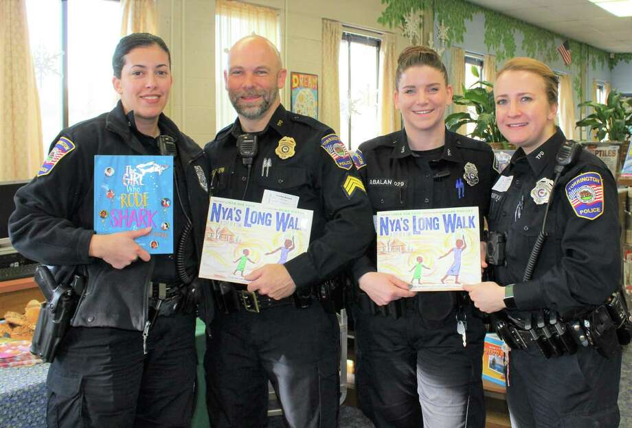 Read Aloud Day was held at area schools on Feb. 12, hosted by the Northwest CT Chamber of Commerce. Above, Torrington police officers show their books before heading into a local classroom to read. Photo: Northwest CT Chamber Of Commerce / Contributed Photo /