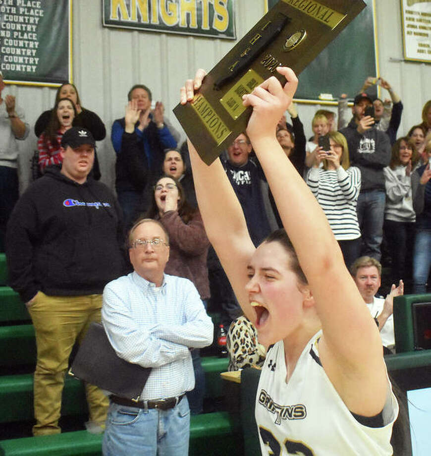 Father McGivney senior Madison Webb screams in celebration after accepting the Class 1A Metro-East Lutheran Regional championship plaque. Photo: Matt Kamp|The Intelligencer