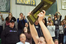 Father McGivney senior Madison Webb screams in celebration after accepting the Class 1A Metro-East Lutheran Regional championship plaque.