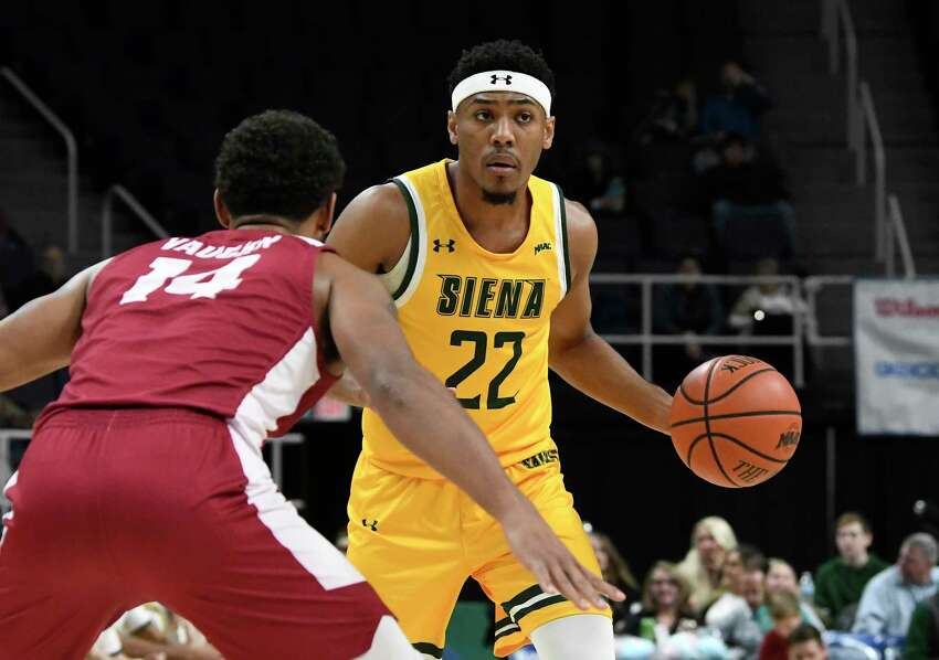 Rider guard Dimencio Vaughn (14) defends against Siena guard Jalen Pickett (22) during the first half of an NCAA basketball game Friday, Feb.14, 2020, in Albany, N.Y. (Hans Pennink / Special to the Times Union) ORG XMIT: 021520_siena_HP116