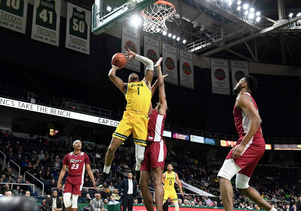 Siena forward Elijah Burns (1) scores against Rider during the first half of an NCAA basketball game Friday, Feb.14, 2020, in Albany, N.Y. (Hans Pennink / Special to the Times Union) ORG XMIT: 021520_siena_HP118