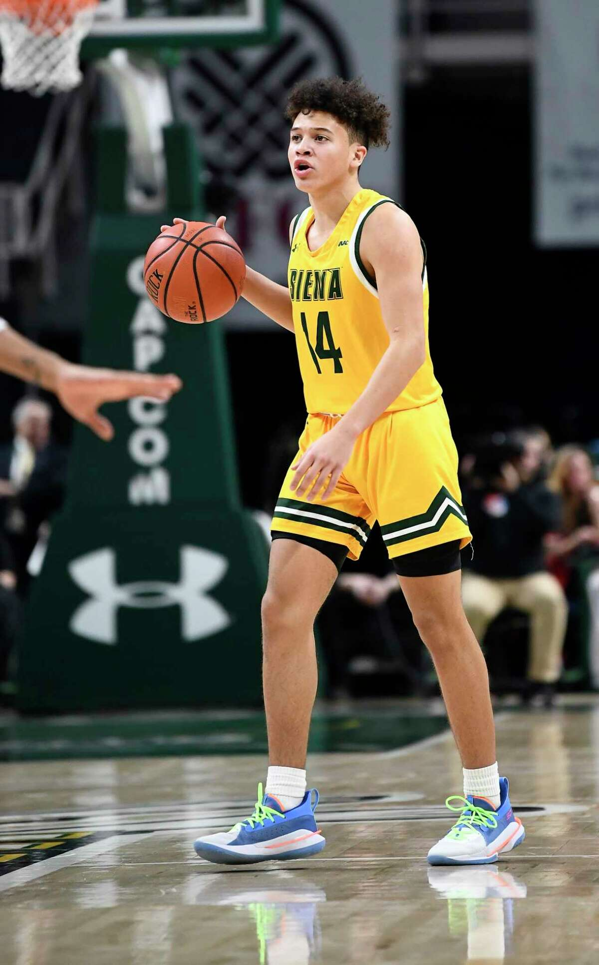 Siena guard Jordan King (14) moves the ball against Rider during the first half of an NCAA basketball game Friday, Feb.14, 2020, in Albany, N.Y. (Hans Pennink / Special to the Times Union) ORG XMIT: 021520_siena_HP124