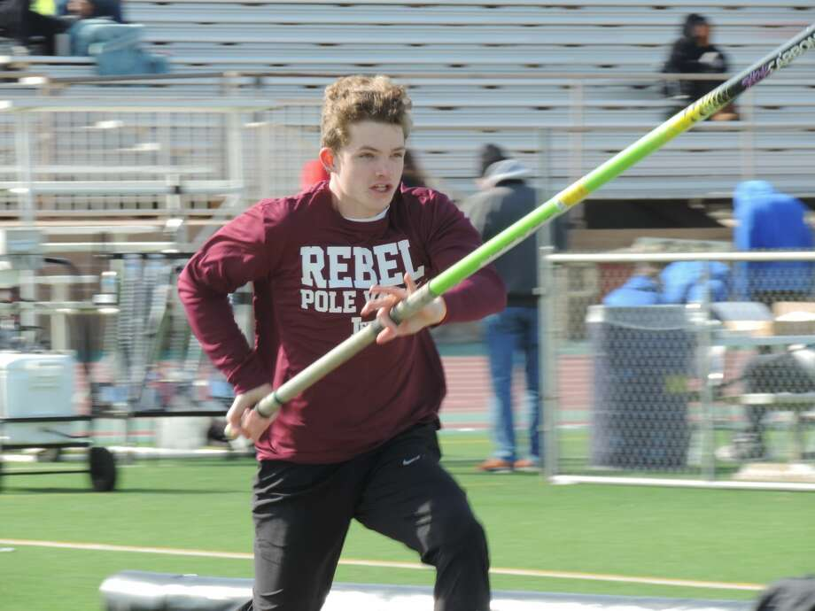 Lee senior Rory Maguire starts his decent toward the pole vault during the Tall City Relays, Feb. 14 at Memorial Stadium. Photo: Christopher Hadorn