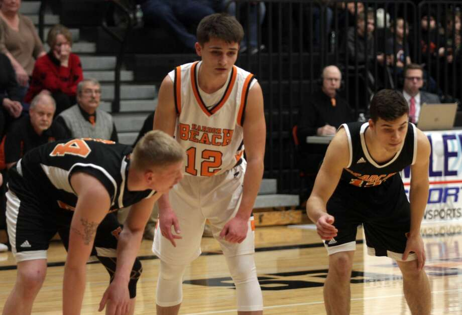 With the game tied 52-52, Dylan Kadar sunk a game-winning, half court buzer-beat to put Harbor Beach over Ubly by a 55-52 margin on Friday, Feb. 14. Photo: Eric Rutter/Huron Daily Tribune