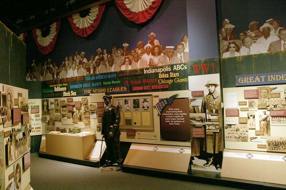 A case with Negro Leagues memorabilia is seen in the baseball gallery at the Sports Museum of America, Thursday May 1, 2008, in New York. The museum is scheduled to open May 7. (AP Photo/Tina Fineberg) Photo: KANSAS CITY CONVENTION & VISITOR / KANSAS CITY CVA