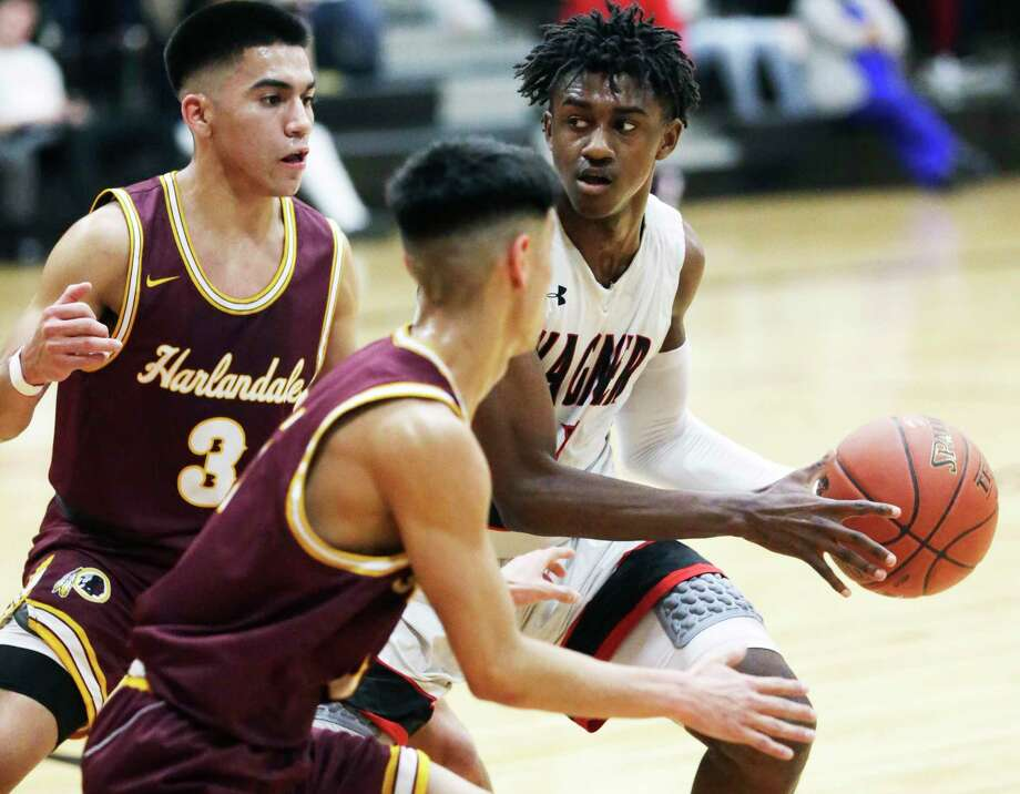 Thunderbird guard Ja'Sean Jackson draws a double team at the top of the key and looks for the open man as Wagner hosts Harlandale in boys basketball on Feb. 14, 2020. Photo: Tom Reel, San Antonio Express-News / Staff Photographer / **MANDATORY CREDIT FOR PHOTOG AND  SAN ANTONIO EXPRESS-NEWS/NO SALES/MAGS OUT/TV